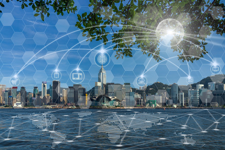 Foto de Communication network with multichannel omni channel of Hong Kong Cityscape river side in the afternoon with smooth cloud at Victoria harbour, Technology Smart City with Internet of Things concept - Imagen libre de derechos