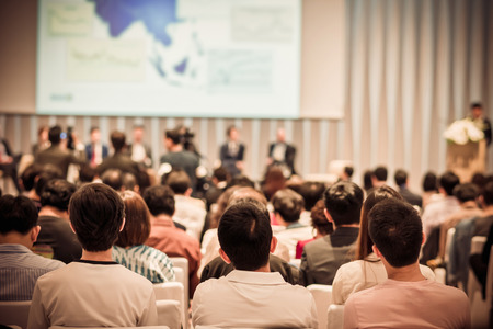 Photo for Rear view of Audience in the conference hall or seminar meeting which have Speakers on the stage, business and education about investment concept - Royalty Free Image