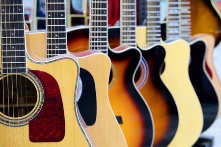 Photo for Guitars in the store background - Royalty Free Image