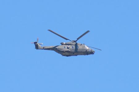 Foto de The image of helicopter in the sky - Imagen libre de derechos
