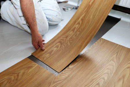 Photo pour Man laying floor PVC - image libre de droit