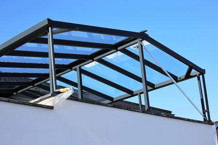 Foto de Modern high-quality balcony canopy, terrace canopy - Imagen libre de derechos