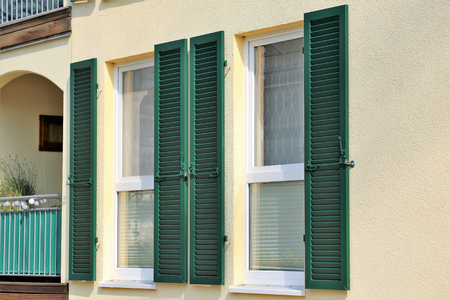 Photo pour Window with wooden shutter, exterior shot - image libre de droit