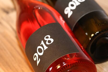 Photo for Close up of two lying wine bottles - Royalty Free Image