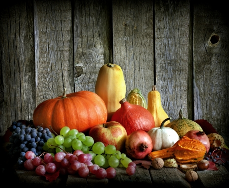 Fruits and vegetables with pumpkins in autumn vintage still life