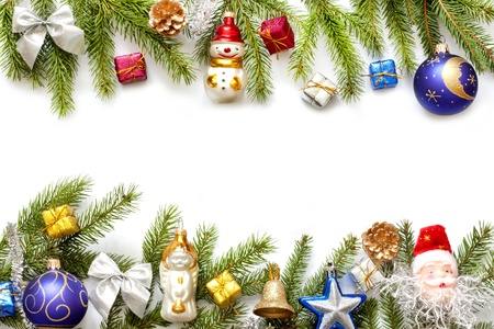 Photo for 	Christmas background border with fir and baubles on white - Royalty Free Image
