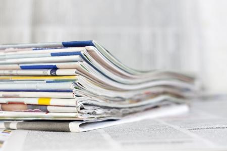 Photo pour Newspapers and magazines blurred background concept - image libre de droit