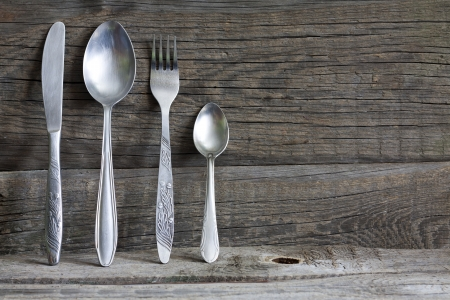 Photo for Cutlery kitchenware on old wooden boards background food concept - Royalty Free Image