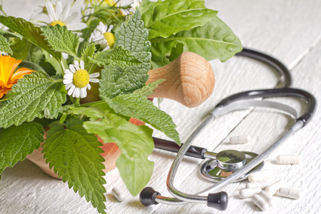 Foto de Fresh herb and stethoscope alternative medicine concept - Imagen libre de derechos
