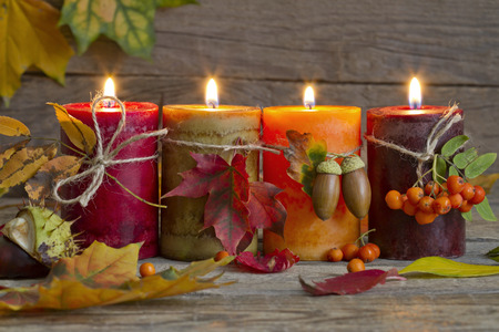 Photo pour Autumn candles with leaves vintage abstract still life in night - image libre de droit