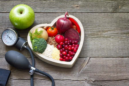 Foto per Healthy food in heart and cholesterol diet concept on vintage boards - Immagine Royalty Free