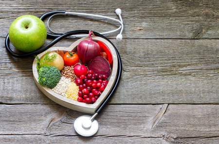 Foto de Healthy food in heart and cholesterol diet concept on vintage boards - Imagen libre de derechos