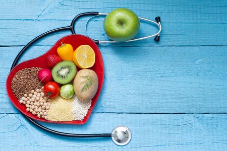 Foto de Food on heart plate with stethoscope cardiology concept - Imagen libre de derechos