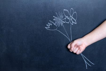 Photo pour Flowers and child's hand abstract background concept - image libre de droit