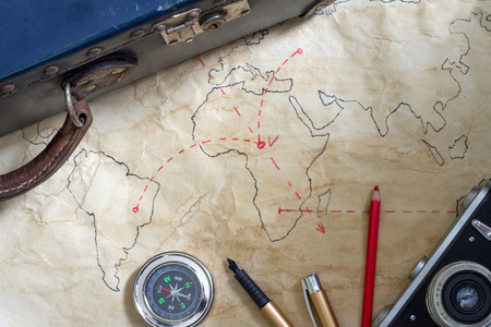 Photo pour Travel plan abstract concept with old maps suitcase and camera - image libre de droit