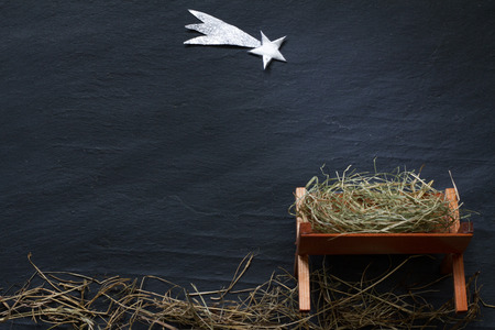 Photo pour Manger and star of Bethlehem abstract Christmas  nativity scene on black marble - image libre de droit