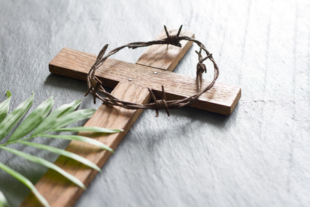 Foto de Easter wooden cross on black marble background religion abstract palm sunday concept - Imagen libre de derechos