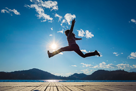 Photo for Girl jumping in the sun - Royalty Free Image