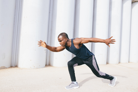 Photo for Healthy young athletic man running at the road - Royalty Free Image