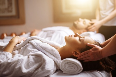 Photo for happy young beautiful couple enjoying head massage at the spa - Royalty Free Image