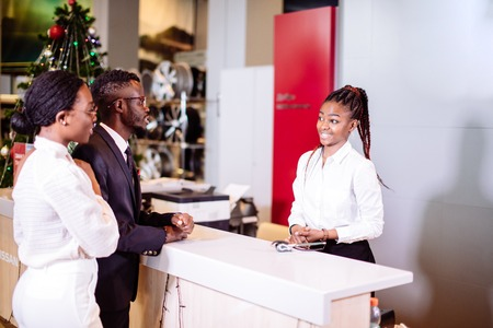 Photo for african Car rental assistant giving information to a couple customer - Royalty Free Image
