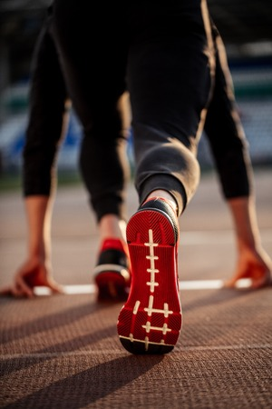 Photo for man feet in starting position for running on race track in stadium - Royalty Free Image