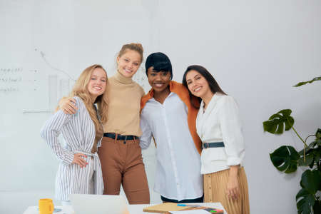Photo for Happy friendly team of caucasian and african business people female together in office look at camera - Royalty Free Image