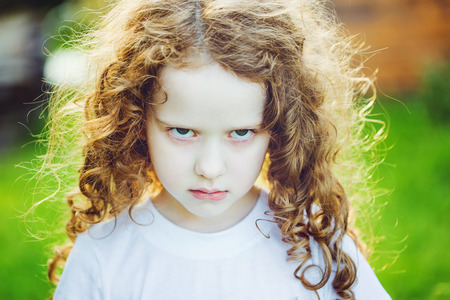 Photo for Emotional child with angry expression on face. - Royalty Free Image