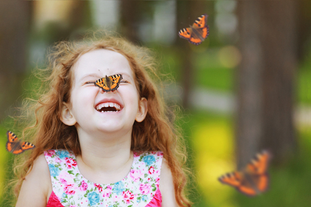 Photo for Funny laughing curly girl with a butterfly on his nose. Healthy smile with white teeth. Free breathing concept. - Royalty Free Image