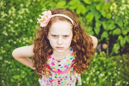 Foto de Emotional princess girl with angry expression on face. - Imagen libre de derechos