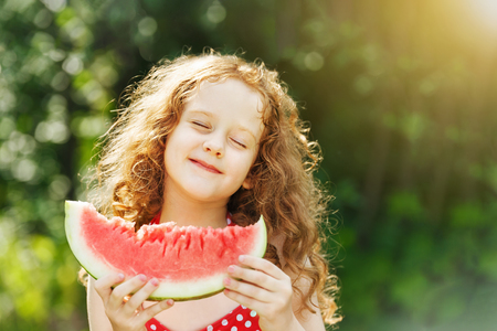 Photo for Girl eating watermelon enjoying closing her eyes. Diet, vitamins, healthy food concept. - Royalty Free Image