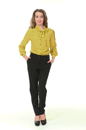 Photo for blond business woman in yellow official formal blouse black trousers high heeled shoes full body portrait isolated on white - Royalty Free Image