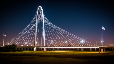 Margaret Hunt Hill bridge by night in Dallas, USA  Margaret Hunt Hill Bridge is a Santiago Calatrava-designed bridge built over the Trinity River