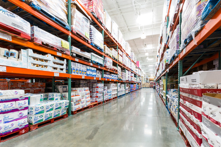Photo for Aisle in a Costco store with napkins, towels and other paper products. Costco Wholesale Corporation, a membership only warehouse club, is the second largest retailer in USA. - Royalty Free Image