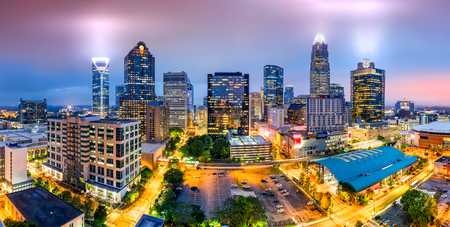 Photo for Aerial view of Charlotte, NC skyline on a foggy evening. Charlotte is the largest city in the state of North Carolina and the 17th-largest city in the United States - Royalty Free Image