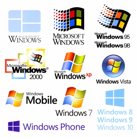 Foto de Evolution of Microsoft Windows logotypes, printed on white paper - Imagen libre de derechos