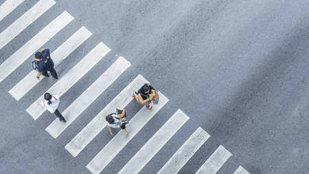 Photo for From the top view of people walk on street pedestrian crossroad in the city street with the motorcycle drives pass road ,bird eye view. - Royalty Free Image