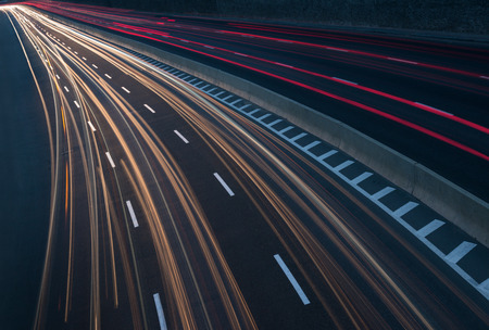 Long exposure image of highway with light trails