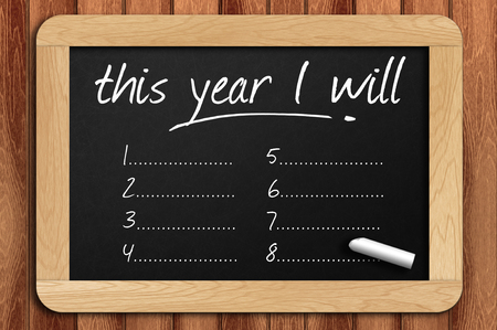 Photo pour Chalkboard on the wooden table written this year I will. - image libre de droit