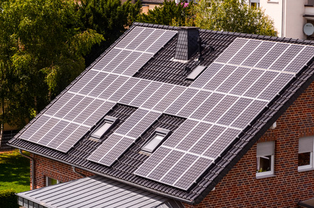 Photo pour Green Renewable Energy with Photovoltaic Panels on the Roof. - image libre de droit