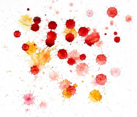 Red and yellow blots of watercolor paint