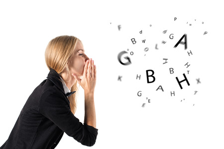Photo for businesswoman talking and letters coming out of her mouth - Royalty Free Image