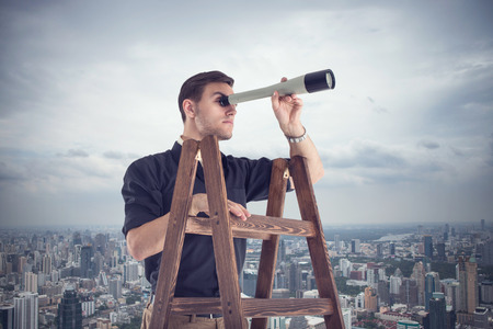 Photo pour Young businessman looking for opportunities through the spyglass standing on the stairs - image libre de droit
