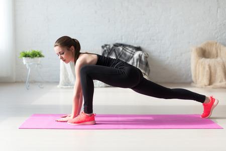 Foto de Women doing exercises aerobics warming up with gymnastics for flexibility leg stretching workout at home fitness. - Imagen libre de derechos