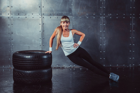Photo for Fitness fit woman sport model doing core, push-ups training workout. - Royalty Free Image