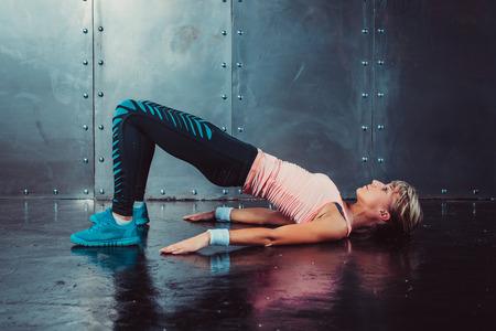 Photo pour Bridge pose sporty woman doing fitness workout yoga stretching gymnastics exercise - image libre de droit