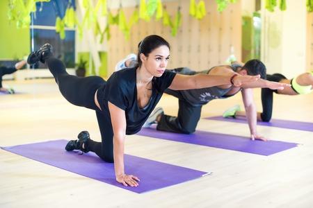 Foto de Group women stretching traning exercising in gym practicing yoga pilates - Imagen libre de derechos
