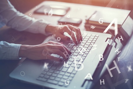 Foto de Working at home with laptop woman writing a blog. Female hands on the keyboard. - Imagen libre de derechos