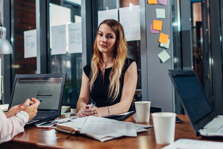 Photo for Smiling woman working sitting in modern office - Royalty Free Image