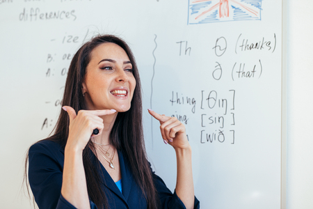 Photo pour English lesson Teacher shows how to pronounce the sounds - image libre de droit